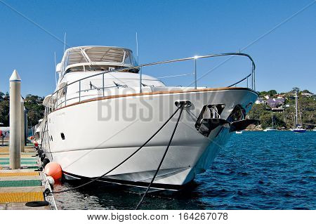 Luxury motor yacht alongside of Wharf. Sydney, Australia.  boat, yacht, motor yacht, cruiser, wharf, jetty, marina, sky, coastal, outdoors, daylight, sunlight,  stock, image,  picture, graphics, Spit Marina, Sydney, new south wales, australia, australian,