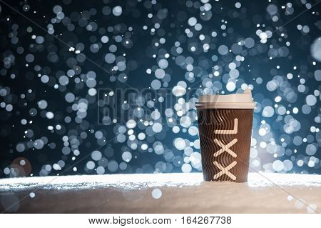 coffee break with hot drink in snowy weather; xxl paper cup with tea on snow background;