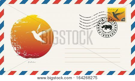 an envelope with a postage stamp with drawing hummingbird bird on a background of the sun