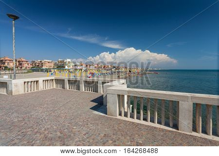 Lido di Ostia ITALY - September 14 2016: View on the private beach Battistini and the pier (Pontile Di Ostia) near beautiful beach Lido di Ostia ( Lido di Roma) Italy.