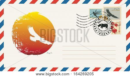 an envelope with a postage stamp with drawing eagle bird on a background of the sun. . Hieroglyph Japan Post Perfection Happiness Truth