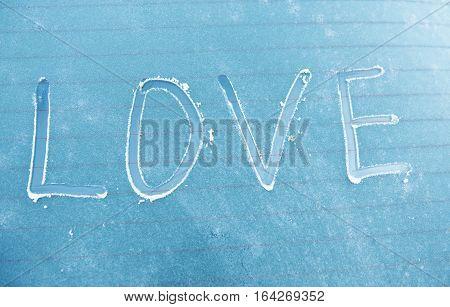 word love written on a frozen car
