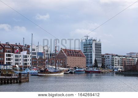 View of the marina in Gdansk on the Motlawa river with small ships in the city center. Poland.