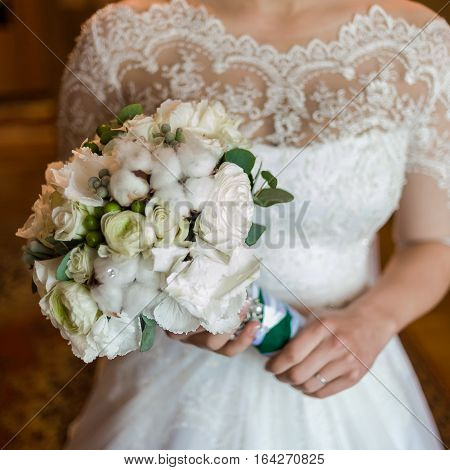 Big wedding bouquet before ceremony. Morning bride