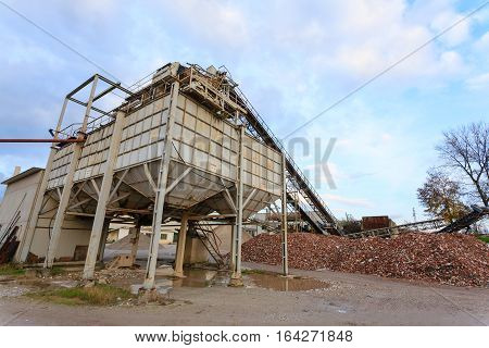 Stone quarry with silos and conveyor belts. Industrial equipment. Mining