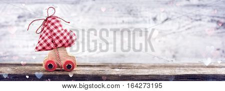 Valentines Day Incoming - Miniature Car Carrying Heart