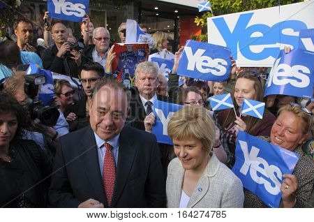 PERTH, SCOTLAND, UK - 12 Sep 12, 2014: First Minister Alex Salmond and Deputy First Minister Nicola Sturgeon during a walkabout with Yes supporters in Perth High Street Scotland UK.