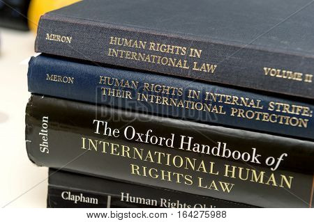 PARIS FRANCE - NOV 27 2016: Stack of diverse human Rights law books preparation for examination exam pass mb and phd thesis