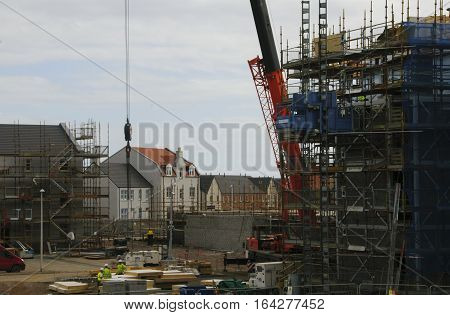 Aberdeen, Scotland, Uk - Sep 1, 2014: Builders At Work On A Housing Estate Under Construction In Abe