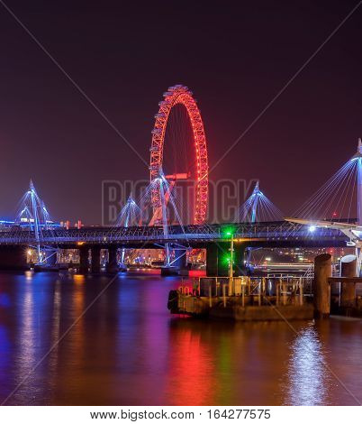 Hungerford Bridge and River Thames skyline at night