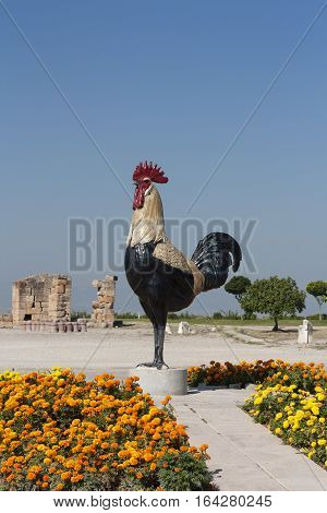 Chicken rooster statue at at Pamukkale Turkey. Pamukkale meaning