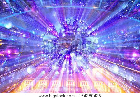 an Abstract image of lights streaks coming from a christmas wreath on a holiday display on the island of macau lit up at night with lights in Asia.