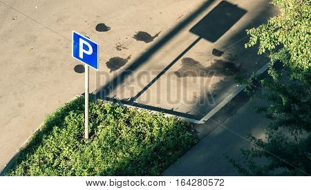 dirty street parking with its road- sign