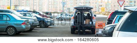 wide shot of the supermarket parking lot