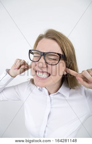 Blond Woman In Glasses With Fingers In Ears