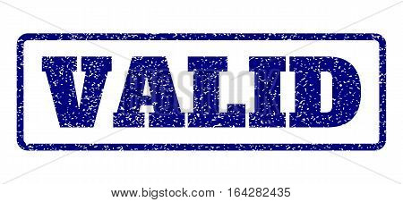 Navy Blue rubber seal stamp with Valid text. Vector message inside rounded rectangular frame. Grunge design and dirty texture for watermark labels. Horisontal sticker on a white background.