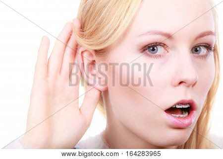 Rumors gossip and gestures concept. Blonde woman listening carefully with hand close to ear