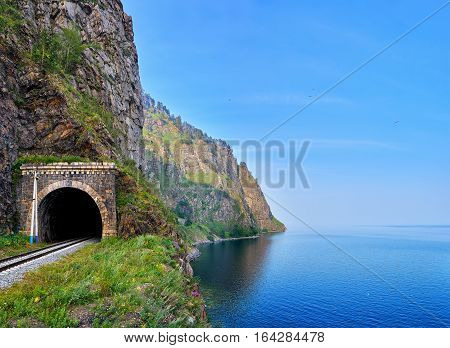Railway Tunnel At Edge Of Land From Deepest Lake Baikal