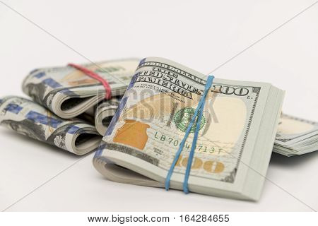 Packs of hundred dollar banknotes with rubber bands