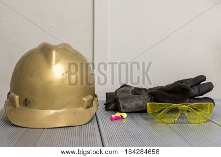 Personal Protective Equipment isolated on a table.