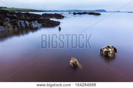 long exposure image of calm ocean waters at a Cornwall beach