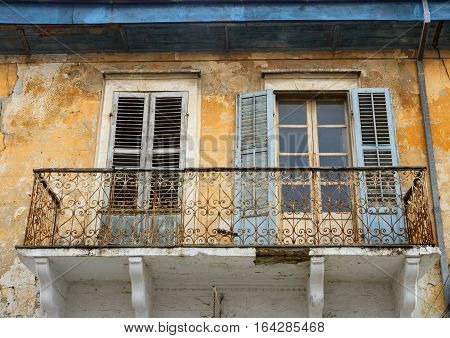 Balcony and windows with of an old abandoned house in Limassol,Cyprus island ,typical mediterranean style