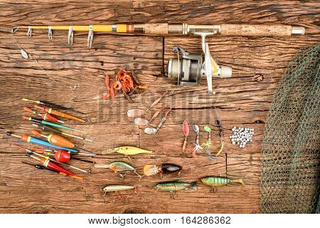 Fishing equipment with fishing root and lure on a wooden table