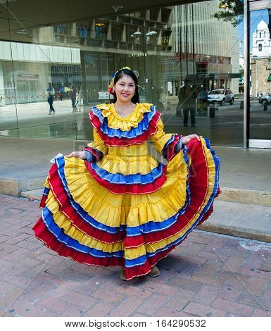 Bogota, Colombia - December 11, 2016: A woman dressed in traditional Colombian dress in front of a gold museum