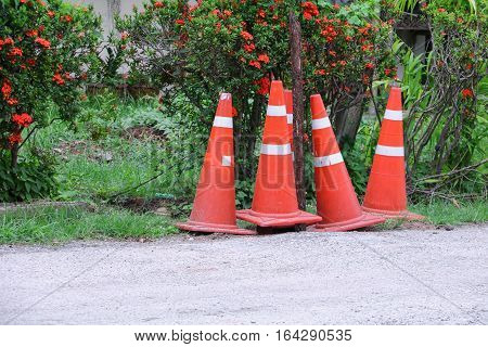 Traffic cone row white and orange stripes set are roadside with copy space