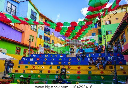 GUATAPE, COLOMBIA - DECEMBER 14, 2016: Colorful streets and decorated houses of Guatape city near Medellin, Antioquia, Colombia