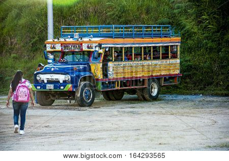 GUATAPE, COLOMBIA - DECEMBER 14, 2016: Colorful chiva buses are important part of rural public transport in Colombia
