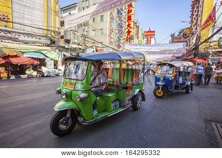 THAILAND BANGKOK - FEB 24 : TukTuk car on traffic in Yaowarat Road main street in Chinatownone of Bangkok landmark in bangkok on february 242015 in China town Bangkok Thailand