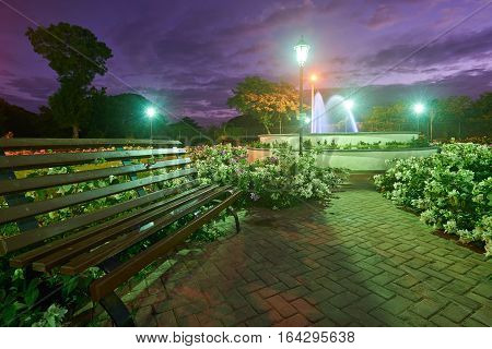 Fountain in park with flowers in Leon NIcaragua in sunset time