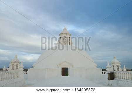 Architecture detail on white roof with blue sky background