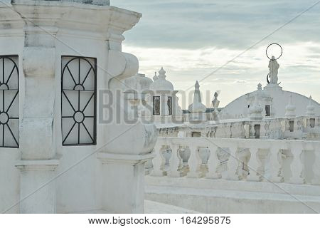 Roof of central church in Leon in sunset time