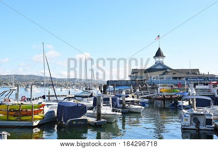 NEWPORT BEACH CALIFORNIA - JANUARY 6 2017: The Balboa Pavilion and boats. On Newport Bay the Pavilion is the center of waterfront activities.