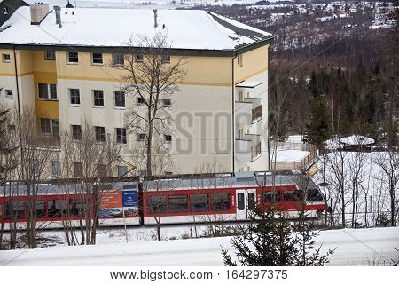SLOVAKIA HORNY SMOKOVEC - JANUARY 05 2015: High speed electric train moves through the Horny Smokovec. Is a ski village located in the mountains of the High Tatras at an altitude of 950 m a.s.l.