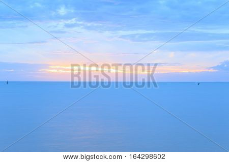 sunset at sea or ocean, with quiet feel or blue tone, sea landscape.