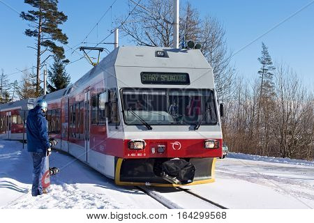 SLOVAKIA HORNY SMOKOVEC - JANUARY 05 2015: High speed electric train arrived on the railway station in Horny Smokovec. Is a ski village located in the High Tatras at an altitude of 950 m a.s.l.