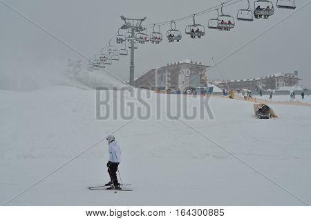 ski lift, chairlift against grey sky background. Winter ski sport