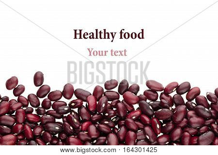 Border of red kidney beans closeup with copy space on white background. Isolated. Healthy protein food.