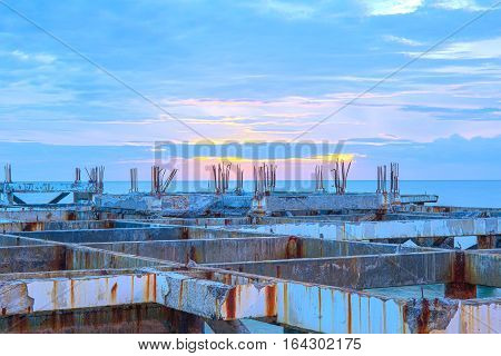A construction site with sunset at sea or ocean, with quiet feel or blue tone, sea landscape.