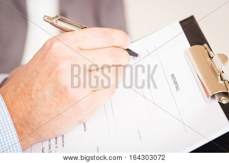 man filling out a german rental agreement mietvertrag