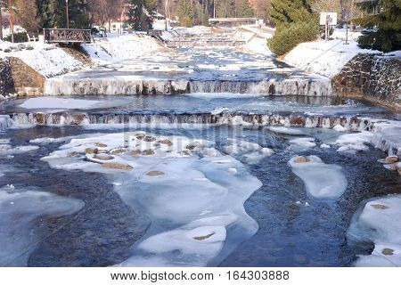 River Labe (Elbe) with ice in winter in the ski areal Spindleruv Mlyn, Czech Republic