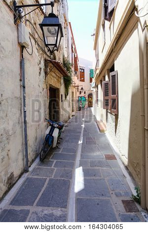 Rethymnon, Island Crete, Greece - July 1 2016: The narrow street with street lamp in Rethymnon (part of Old Town)