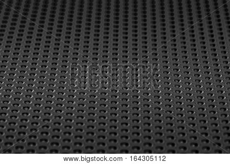 selective focus of black matte metal net modern pattern background in the dark tone