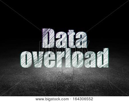 Information concept: Glowing text Data Overload in grunge dark room with Dirty Floor, black background