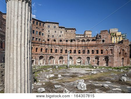 Trajan's Market (Latin: Mercatus Traiani Italian: Mercati di Traiano) is a large complex of ruins in the city of Rome Italy located on the Via dei Fori Imperiali at the opposite end to the .
