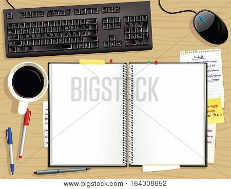 An image of a ring bound blank book on an office desk.