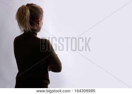 Rear View Of Young Woman Looking Away